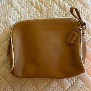 Tan and white coach bag